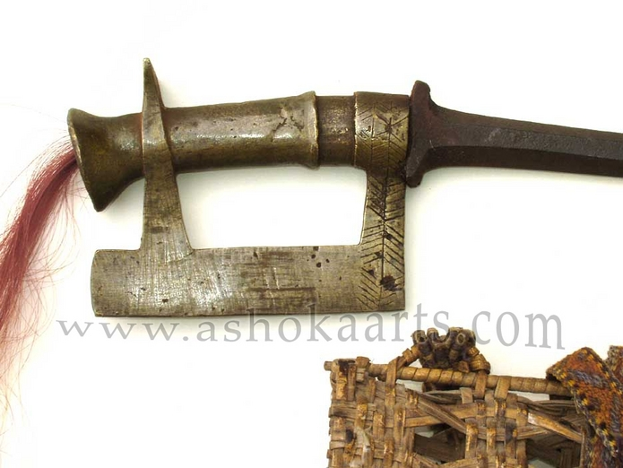 A rare Shendu minority 'Naga' axe knife complete with woven sheath