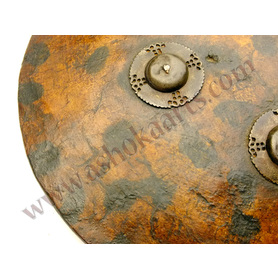 Indian thick hide shield with tortoiseshell painted decoration