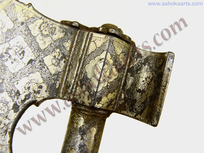 panels of silver and gold geometric patterning on Indian Ax