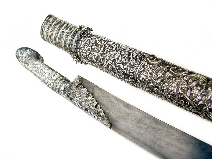 A fine greek or turkish yataghan sword with damascus 'ribbon' patterned blade and fine chiselled silver mounts