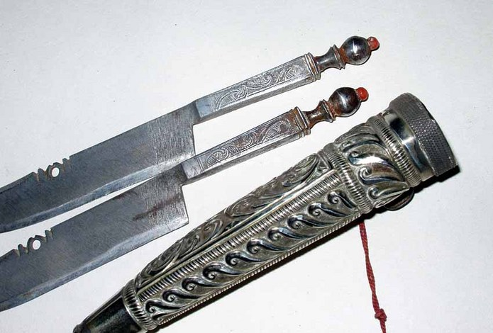 Twin Greek knives Mounted with silver and coral in one Sheath